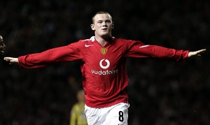 Rooney celebrating one of his three goals on his fairy-tale Manchester United debut in 2004.